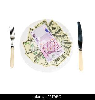 Dinero en la placa aislada sobre fondo blanco. Foto de stock