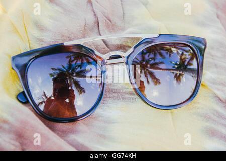 Reflejando los días de playa Foto de stock
