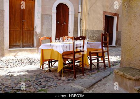street scene outside restaurant, bosa, cerdeña, italia