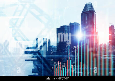 Doble explosure con gráficos de negocios y el distrito de la ciudad de megapolis