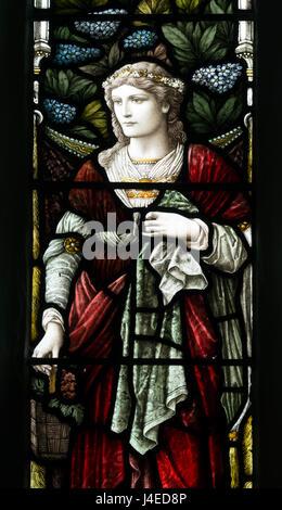 La caridad vidriera, Santa María y la Iglesia de Todos Los Santos, Holcot, Northamptonshire, Inglaterra, Reino Unido.
