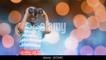 Compuesta Digital de sonriente niño mirando a través de binoculares sobre bokeh