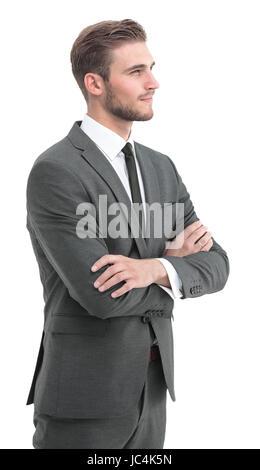 Hombre joven de éxito en traje completo sonriendo. Mirando hacia el lado.