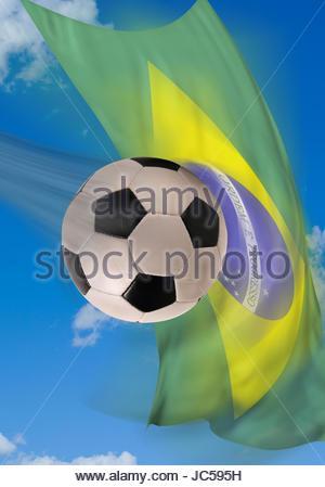 12da25aa54c0d Balón de fútbol rápido volando con la bandera de Brasil en el fondo. Foto de
