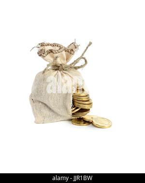 Concepto de negocio. Agujero-montado con sacos de arpillera monedas derramado