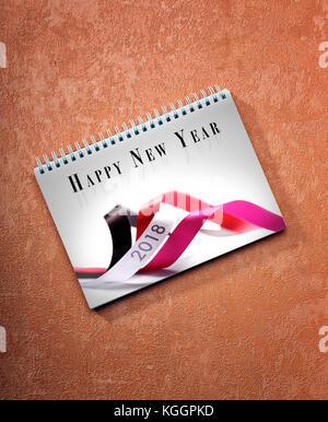 Feliz año nuevo 2018 calendario de mesa sobre fondo pintado, camino de la primera hoja.