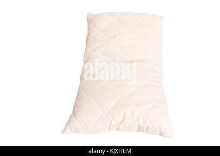 Almohada de tela blanca sobre fondo blanco. Foto de stock