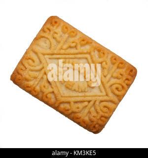 Un flan de galletas crema sobre un fondo blanco. Foto de stock