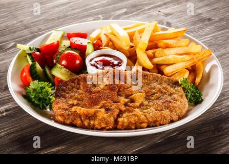 Pork Chop fritos, patatas y verduras