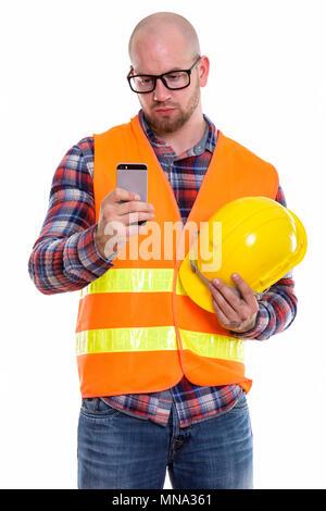 Joven Hombre muscular calva, trabajador de la construcción Foto de stock