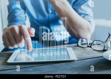 Empresario utilizando la tecnología digital para empresas start-up, gráfico de columnas 3D