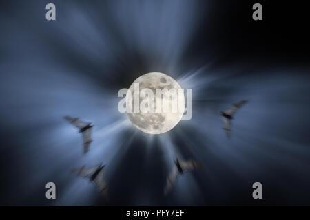 Foto composición con luna llena de noche, los murciélagos en vuelo y haces de luz (agregado algún ruido digital)
