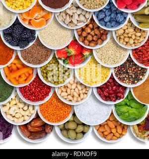 Frutas y verduras alimentos especias ingredientes bayas de fondo cuadrado espacio copia copyspace fruta desde arriba Foto de stock