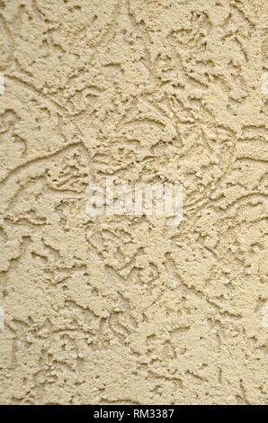 La textura del yeso decorativo beige en corteza escarabajo estilo. Federación de variación de decorar paredes de fachada