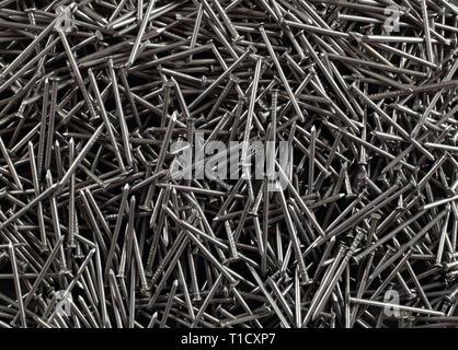 Construcción, reparación, herramientas - abstracto metall montón clavos antecedentes