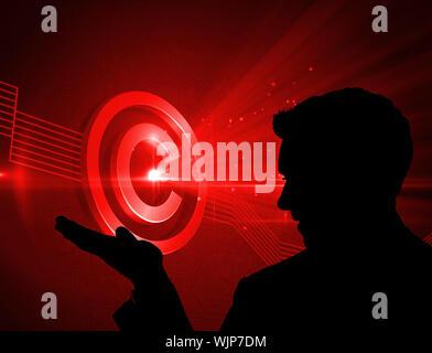 Imagen compuesta de color rojo brillante icono de copyright sobre fondo negro