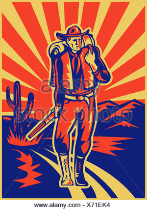 Vaquero con mochila y fusil caminando Foto de stock