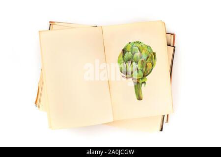 Ouvrir un vieux livre avec une illustration d'une copie d'artichaut et d'espace, un modèle de conception de recette, tourné à partir de ci-dessus, sur un fond blanc Banque D'Images
