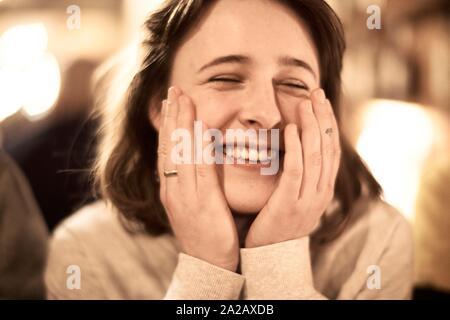 Portrait of happy woman indoors in restaurant