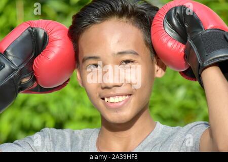 Un Wearing Boxing gloves Banque D'Images