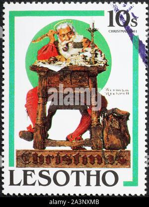 Le Père Noël la lecture de lettres de cachet, illustration par Norman Rockwell