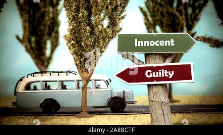 Plaque de rue la Direction façon d'innocent et coupable Banque D'Images