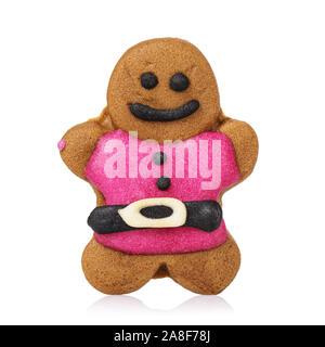 Les biscuits de Noël en forme d'un homme. Gingerbread avec glaçage rose isolé sur fond blanc Banque D'Images