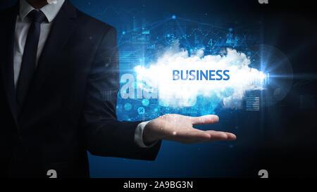 Part of Businessman holding inscription d'affaires, concept d'entreprise réussie Banque D'Images