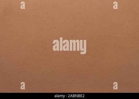 Mur de plâtre brun-orange, bien texturé pour le fond ou le papier peint Banque D'Images
