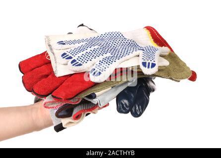 Des gants en caoutchouc en pile sur une main. Banque D'Images