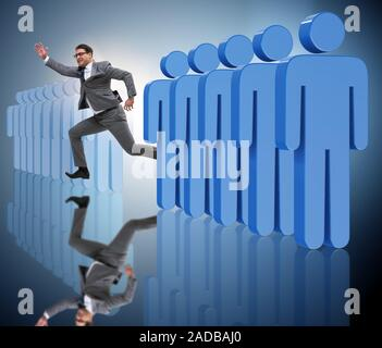 Se démarquer de foule concept avec Businessman Banque D'Images
