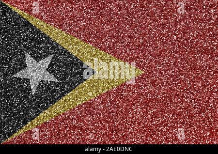 Drapeau Timor Leste représenté sur beaucoup de petites paillettes brillantes. Festival haut en couleurs de fond de disco party
