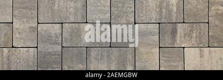 Blocs de forme régulière, la texture, l'arrière-plan. Dalles de blocs gris de forme plate, close-up. Un nouveau revêtement dans le parc de la ville