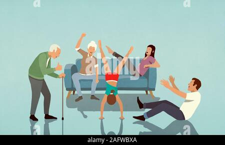 Happy family cheering girl doing handstand in living room Banque D'Images