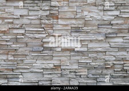 Les murs de fond en pierre sont empilés. Fond et papier peint en pierre. Banque D'Images
