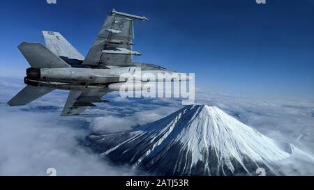Un avion de chasse Super Hornet de la marine américaine F/A-18 F effectue un tour bancaire près du monument japonais Mt. Fuji pendant les opérations de vol le 29 janvier 2020 près d'Atsugi, Japon.
