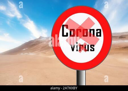 Image molle d'un panneau d'arrêt rond rouge dessert avec étiquette Coronavirus. Concept de quarantaine de maladies infectieuses. Banque D'Images