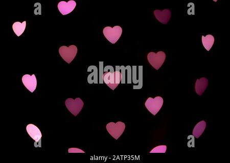 Arrière-plan de Valentines. Cœur abstrait bokeh arrière-plan. Lumières floues en forme de coeur floues. Concept d'amour.