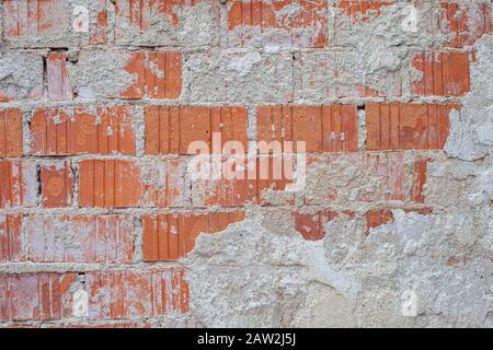 mur de briques avec le reste du plâtre sur un vieux bâtiment avec une structure distinctive Banque D'Images
