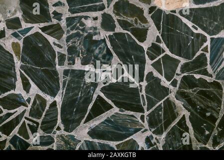 Carrelage au mur ou au sol en marbre. Texture en marbre avec motif. Fond sombre abstrait.