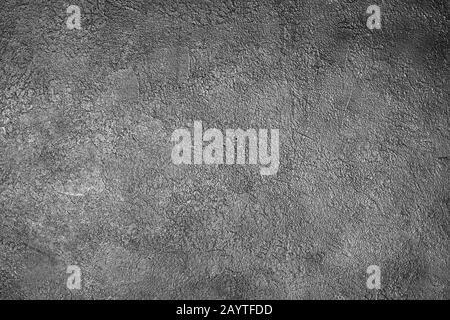 Fond en stuc gris foncé gros plan, fond gris clair de texture de ciment rugueuse, mur texturé en béton grunge, plâtre argent brillant décoratif Banque D'Images
