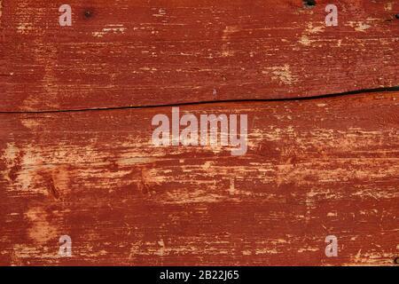 mur en bois de la vieille maison, couleur rouge peinte, texture en bois naturel ou arrière-plan Banque D'Images
