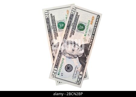 Deux billets de vingt dollars américains sur fond blanc isolés gros plan, 20 dollars américains fan, ont bronzé argent papier en espèces vue de dessus