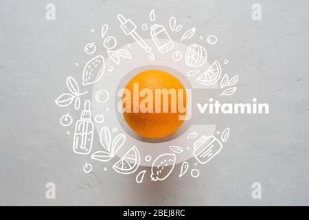 Orange et lettre C sur fond jaune. Les icônes de style Doodle image plate lay concept de protection de l'immunité pendant l'infection virale Banque D'Images