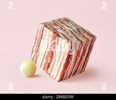 cube de tranches de prosciutto et de boules de melon sur fond rose Banque D'Images