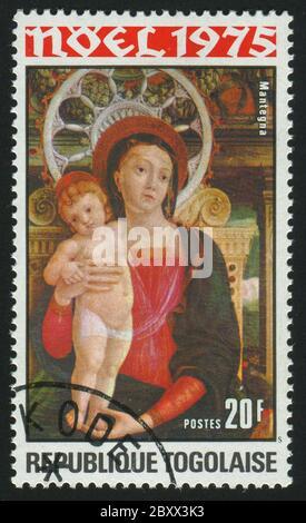 RÉPUBLIQUE TOGOLAISE -VERS 1975: Timbre imprimé par le Togo, montre photo, Vierge et enfant, vers 1975. Banque D'Images