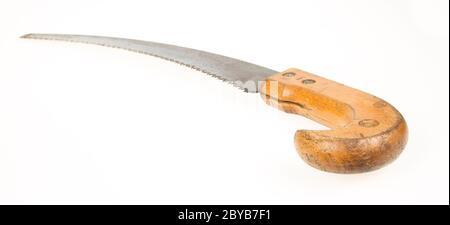 Old rusty toy scie à main sur blanc Banque D'Images