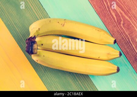 Trois fruits mûrs de banane Banque D'Images