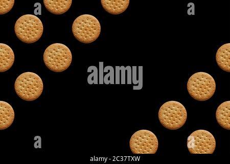 motif avec des cookies encerclant sur fond noir. Placer pour le texte Banque D'Images