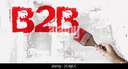 Abréviation B2B en rouge et pinceau à portée de main sur fond gris blanc. Image de concept Business to Business Banque D'Images